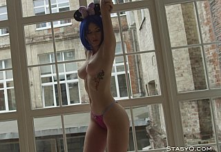 Blue-haired girl revealing her exquisite body